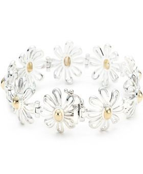 Tiffany & Co Chrysanthemum Bracelet is an unfailingly feminine piece. The graceful bracelet was made of nine pieces of chrysanthemums with gold emblishment. It looks beautiful and is the best adorement for your everyday luxury look.    Product Features:  Chrysanthemum Bracelets  Sterling Silver and Gold  Manufacturer: Tiffany & Co. jewelry