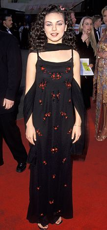 February 1, 1999 Kunis tried her best to channel old Hollywood glamour at the 1st Annual TV Guide Awards.