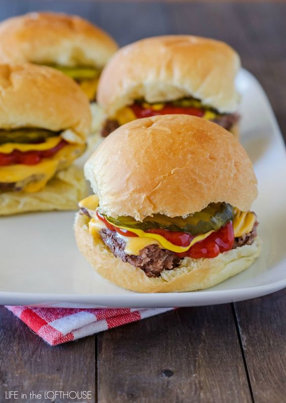 Oh goodness, these sliders. Ridiculously easy to make AND ridiculously good! These cheeseburger sliders are a new family favorite!    I love how these sliders are prepared. No need to form a bunch of hamburger patties when you make these little babies. You just press the meat into a baking dish …