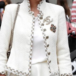 Chanel ...Jacket As always - works with a collar if one can wear Chanel as a priest ...: