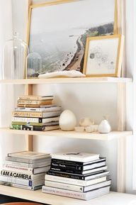 simple white and gold bookshelf styling