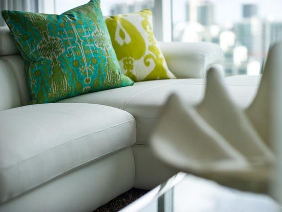 Throw pillows break up an all-white palette and give some additional interest to the sectional.