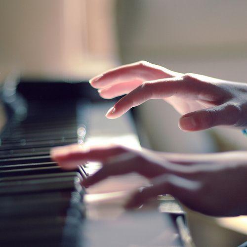 Playing piano.