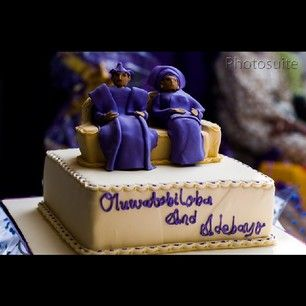 Yummy traditional Nigerian wedding cake with couple in purple.
