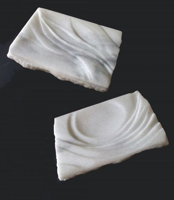 Cararra marble Wall Mounted or Wall Hanging sculpture by artist Krystyna Sargent titled: 'Pair of platters (Carved marble Low/Bas Relief Panels/Plaques)'