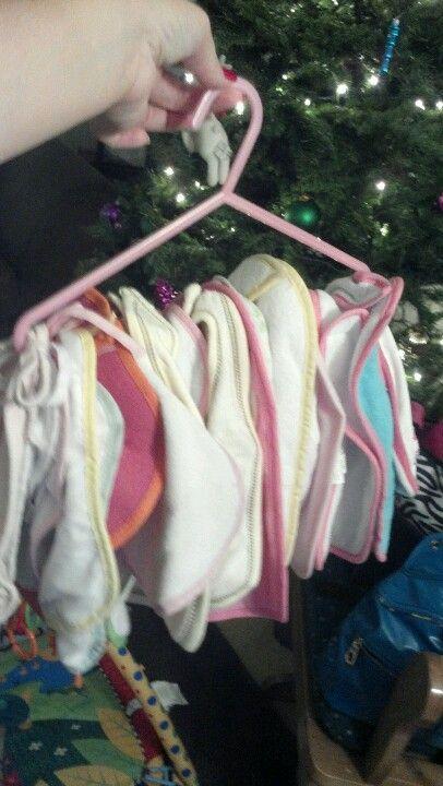 Baby Bib storage-coat hanger to clear up shelf space!