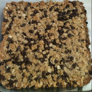 Homemade Granola bars! 2 1/2c rolled oats  1/2c flour 1/2 tsp baking soda 1/2 tsp vanilla 1/3c butter softened or melted 1/4c honey 1/4c packed brown sugar 3/4c mini chocolate chips or raisins Press into a greased 8x8 pan Bake 325 for 20-25 min Makes 18 bars