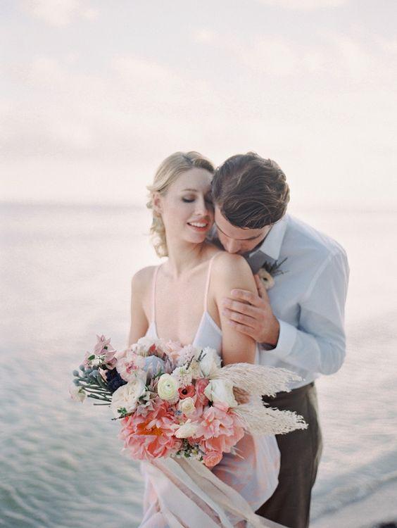 A Bride and Groom Embracing | Melanie Gabriel Photography on @bajanwed via @aislesociety