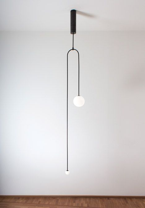 Michael Anastassiades creates minimal lighting designs from glowing spheres.: