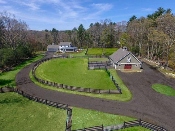 Equestrian Estate For Sale in Middlesex County, Massachusetts, Unique Opportunity: STUNNING NEWLY CONSTRUCTED Contemporary Farmhouse set far off the road on 6+ Acres with impressive EQUESTRIAN amenities in a premier MetroWest Boston town known for it's TOP RANKED PUBLIC SCHOOLS & abundance of beautiful, publicly ACCESSIBLE TRAILS.