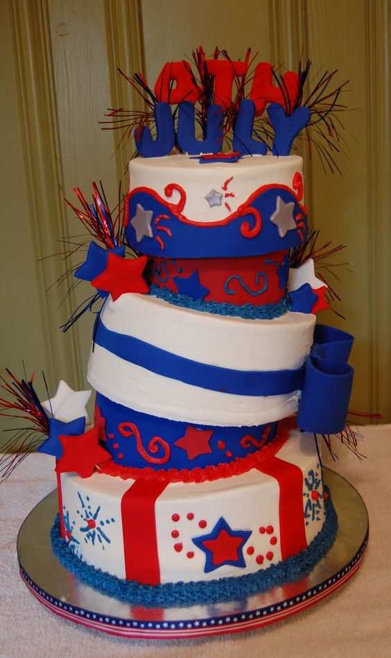 4th of July Topsy Turvy - Chocolate , vanilla and almond cake with butter cream icing and fondant accents