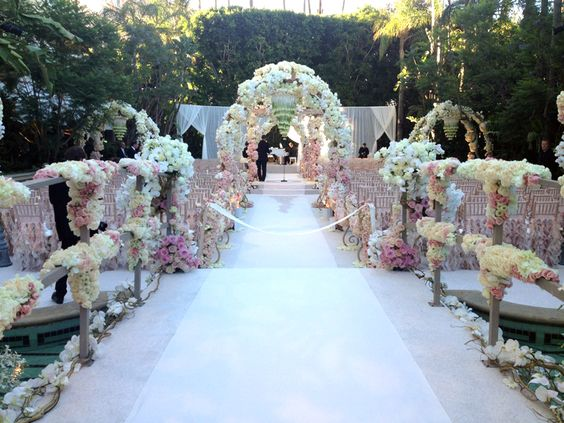 wow  an aisle draped in florals was the definition of