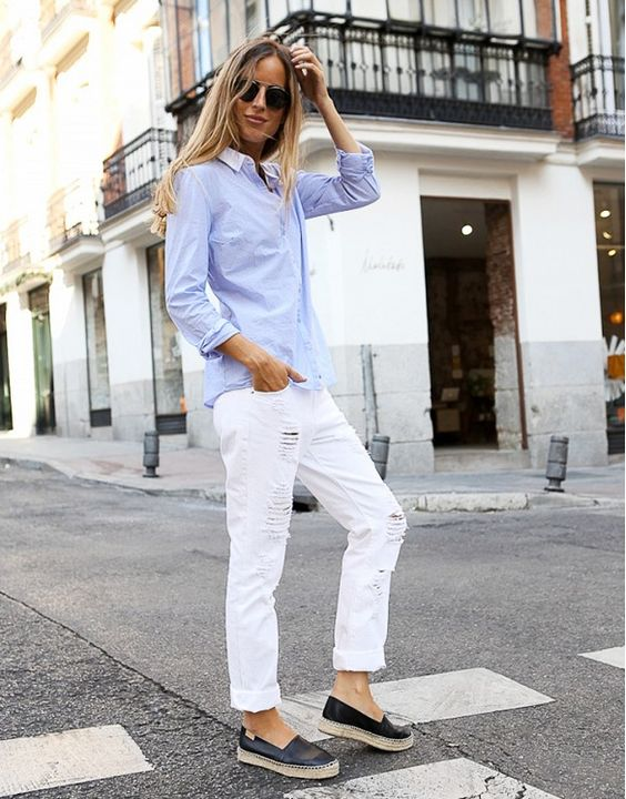 Distressed white boyfriend jeans, a breezy button,up shirt and espadrilles make for the