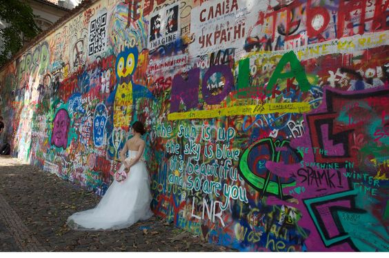 The John Lennon Wall in Prague - once a plague for Communism - now attracts graffiti artists, photographers, tourists ...and brides. Photo Ursula Maxwell-Lewis (c)