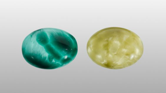 Glass, such as this material, can be made to look like a variety of gemstones; in this case glass makes a convincing substitute for malachite (left) and rutilated quartz (right).: