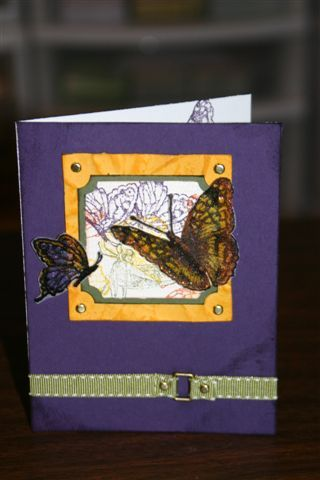OSW Butterfly 3  Stamps: on gossamer wings Paper: eggplant, summer sun, ww, artichoke Ink: eggplant, summer sun, really rust, eggplant, versamark Accessories: buckle, brads, ticket corner punch, markers, embossing powders