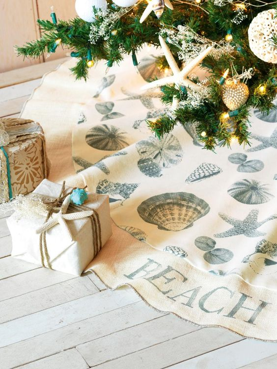 To give your presents a trendy coastal look, wrap gifts in canvas or cotton duck secured in the corners with heavy-duty double-sided tape. Embellish with jute or hemp twine and top with shells you've found on the beach. Image courtesy of Eastern Accents.