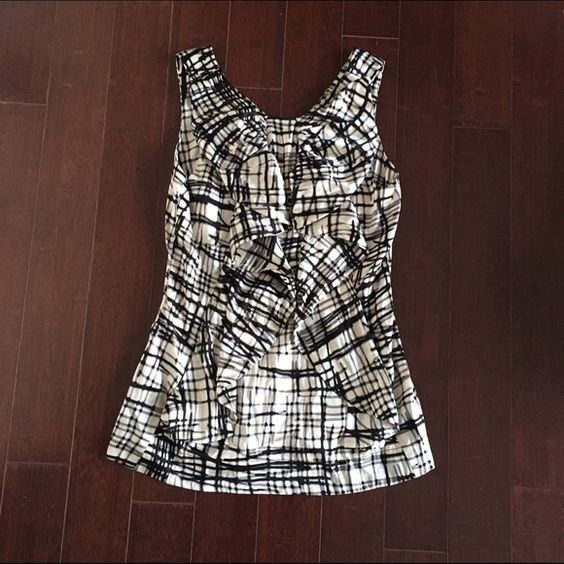 BCBG Silk, Sleeveless Blouse (Medium) BCBG black and white patterned sleeveless blouse. Size Medium. 95% Silk and 5% Spandex. Wore once after being purchased. The shirt even has hidden pockets. BCBG Tops Blouses