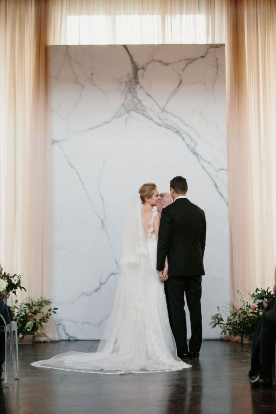 Sleek marble ceremony backdrop // Unique wedding backdrops