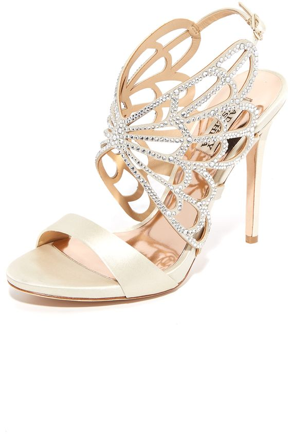 Slim, crystal-studded straps create a wing shape on these satin Badgley Mischka sandals. Buckle closure. Covered stiletto heel. Leather sole.  Fabric: Satin. Imported, China. Measurements Heel: 4.5in / 115mm
