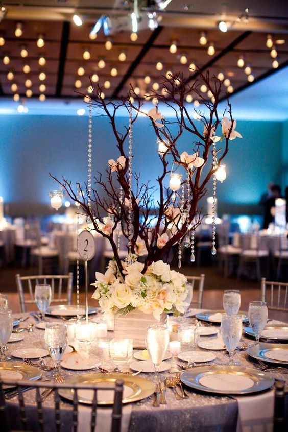 Elegant tall centerpiece idea with flowers and tree