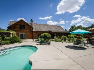 Gorgeous 3 bdrm log home on acreage w/ inground pool listed by Janis Hartley - Keefe Real Estate