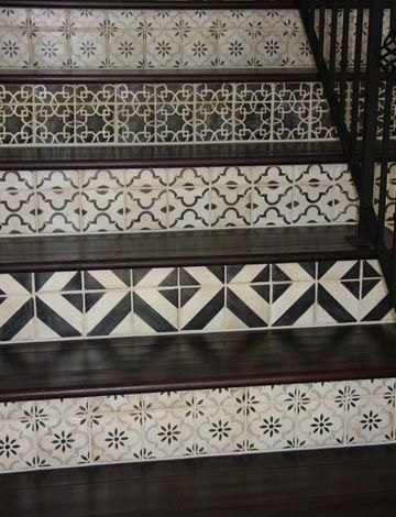 Black and white tiles mix matched and used decoratively on stair risers. #blackandwhite #staircase #tiledstairs