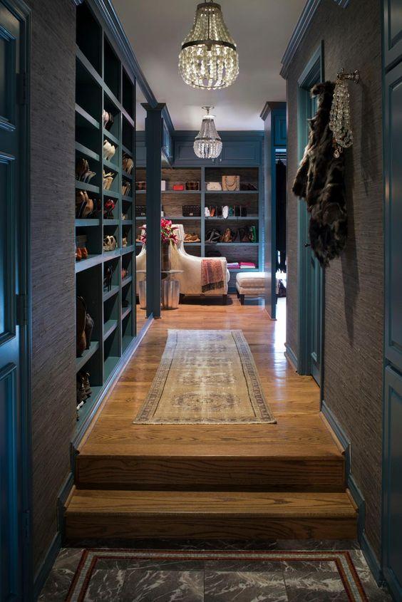 Steel blue walk-in closet with wooden flooring and furniture #dark #closet #storage #organization #allenrothCloset #allenAndRothCloset #closetShelves