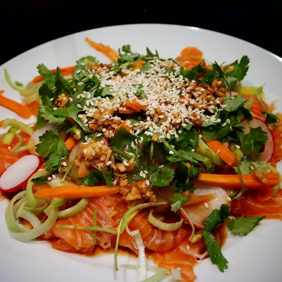 Raw salmon with sesame and coriander