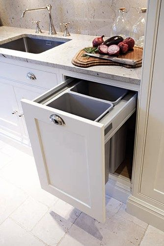 not a fan of the style of kitchen here, but I do like the recycling tubs in the drawer, like we have now- very useful!