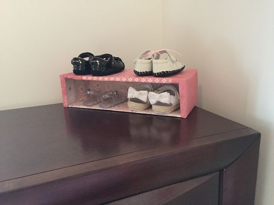 I felt crafty recently and decided to make a little shoe rack for my daughter. I cut one side out of a rectangular cardboard box and covered it with decorative paper.