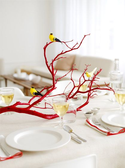WHAT A CUTE IDEA...spray painting a branch and using it as a FREE centerpiece for a dinner party. LOVE!! PP said: So imagine this but painted grey or silver with little fake yellow flowers super glued to it. Like a cherry blossom but in your colors super easy and cheap decor ;)