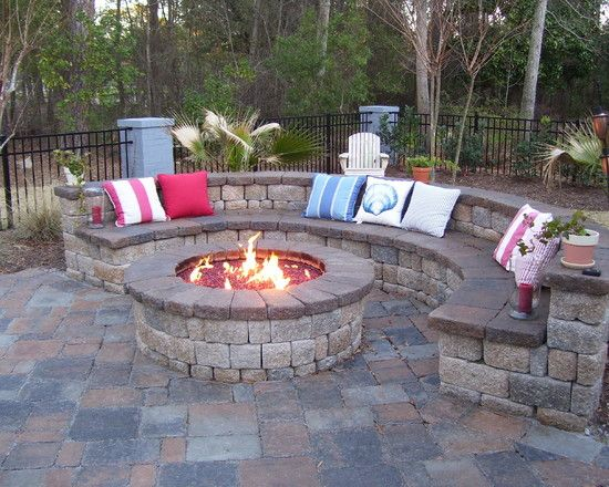 This is what I want to do, except 3/4 circle, lower fire pit, and use cinder blocks for the bench- I can use concrete patch to give it a non-cinder-block facade.
