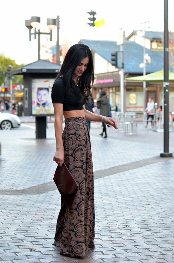 High waist printed palazzo pants with black crop top and burgundy clutch