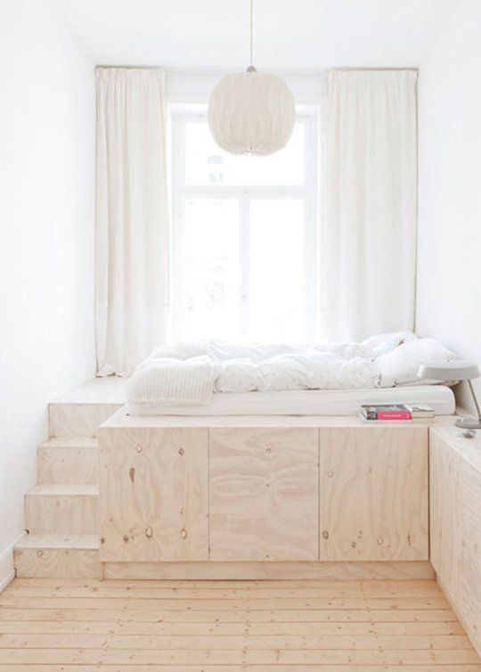 Child's Bedroom with Elevated Plywood Bed and Paper Lantern - love idea of a lofted bed with storage underneath!: