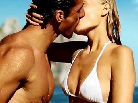 This ad utilizes the principle of association to sell its product. Dolce and Gabbana is associating their fragrance with sex and sensuality by featuring the two very attractive and sexual actors (which is a common factor in ads focusing on products such as perfumes), focusing on their bodies, and the making out. Additionally, the setting takes place in the sea. I would argue the ad is probably trying to convey a sense of freshness and fun as well.