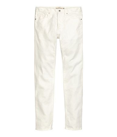 5-pocket jeans in washed, dyed denim with slim legs, regular waist, and button fly.