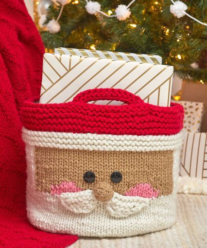 "FREE pattern download - KNIT - Jolly Santa Knit Basket ~ intermediate level ~ measures about 14"" diameter x 13"" tall (35.5cm x 33 cm), measured with basket sitting upright on a flat surface."