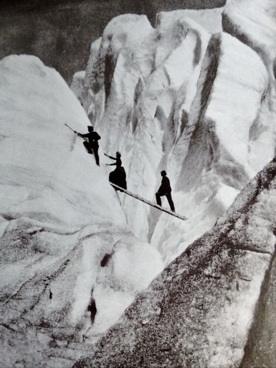 "Late Victorian mountaineers, including a lady fully dressed and corseted, cross a crevasse in the Alps, 1900 (from Getty Images' book ""Decades of the 20th Century—1900s"" by Nick Yapp):"