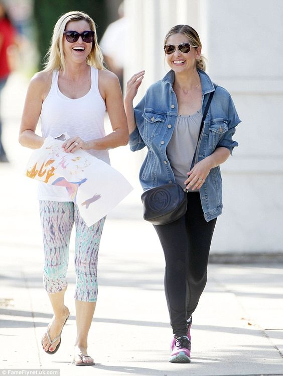 Time for a laugh: The day before Sarah was spotted sharing a joke with a fellow blonde friend during a sunshine stroll