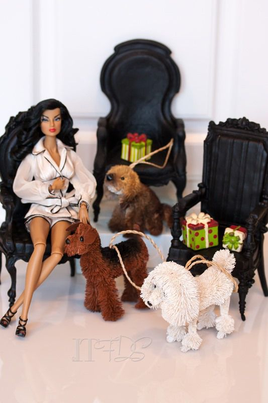 A Christmas décor. Set of black gothic chairs from Victorian  Trading Company. The adorables dogs from Pottery Barn catalog.