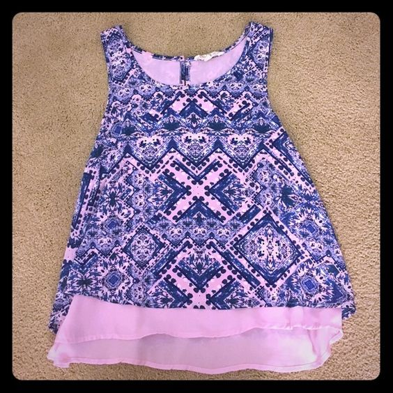 Tribal blue Tank Top with pink chiffon under layer Gorgeous on. Fits the chest snuggly and then flows out slightly to accentuate the waist. Shorter length that hits just at the pant line and is perfect for festivals (I wore it to Music Midtown 2015). The colors are crazy vibrant and the shirt is in perfect condition. Pink Rose Tops Tank Tops