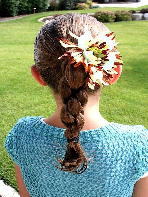 Double-Twist Pony -- 1. Part hair down middle. 2. Begin to twist away from face tightly. Start right next to part & add hair in gradually as you twist. 3. Twist until you reach approximately middle of head in back. Have daughter hold her hair as you twist second side. 4. When you reach middle, twist hair down to about 2 inches above hairs end. 5. Add bottom rubber band first to hold twist in place until you get top rubber band in place. 6. Now place top rubber band right at nape of neck.
