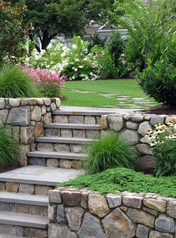 Stone stairs and an irregular stepping stone path lead for Rock stepping stones landscaping