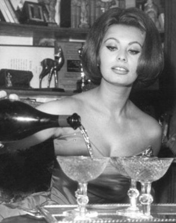 Sophia Loren pouring champagne into vintage coupe glasses