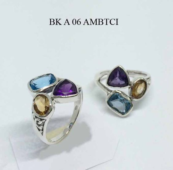 A personal favorite from my Etsy shop https://www.etsy.com/listing/386811346/ring-blue-topaz-citrine-amethyst