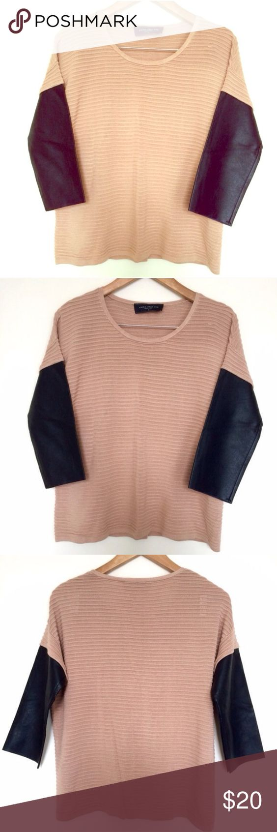 Akira Knit Top with Faux Leather Sleeves - Small Blush/nude top with black faux leather sleeves. Excellent used condition. Size small. AKIRA Tops