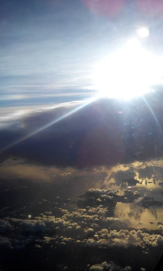 Such heavenly skies. Took this picture when I was travelling back to Manila. :)