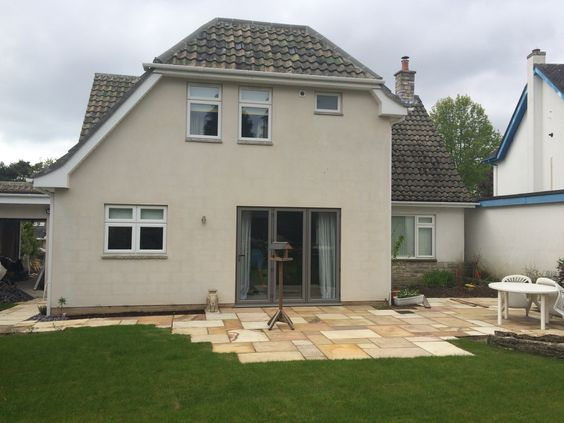 Rear extension landscaping with a patio and turf