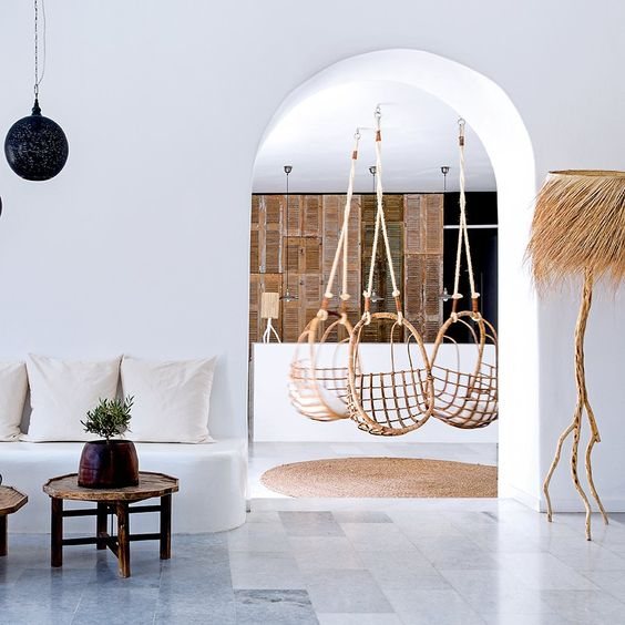 Rattan swings, rustic decor, and white plaster walls in dreamy San Giorgio, Hotel in Mikonos. #rusticdecor #swing #chair #Greece